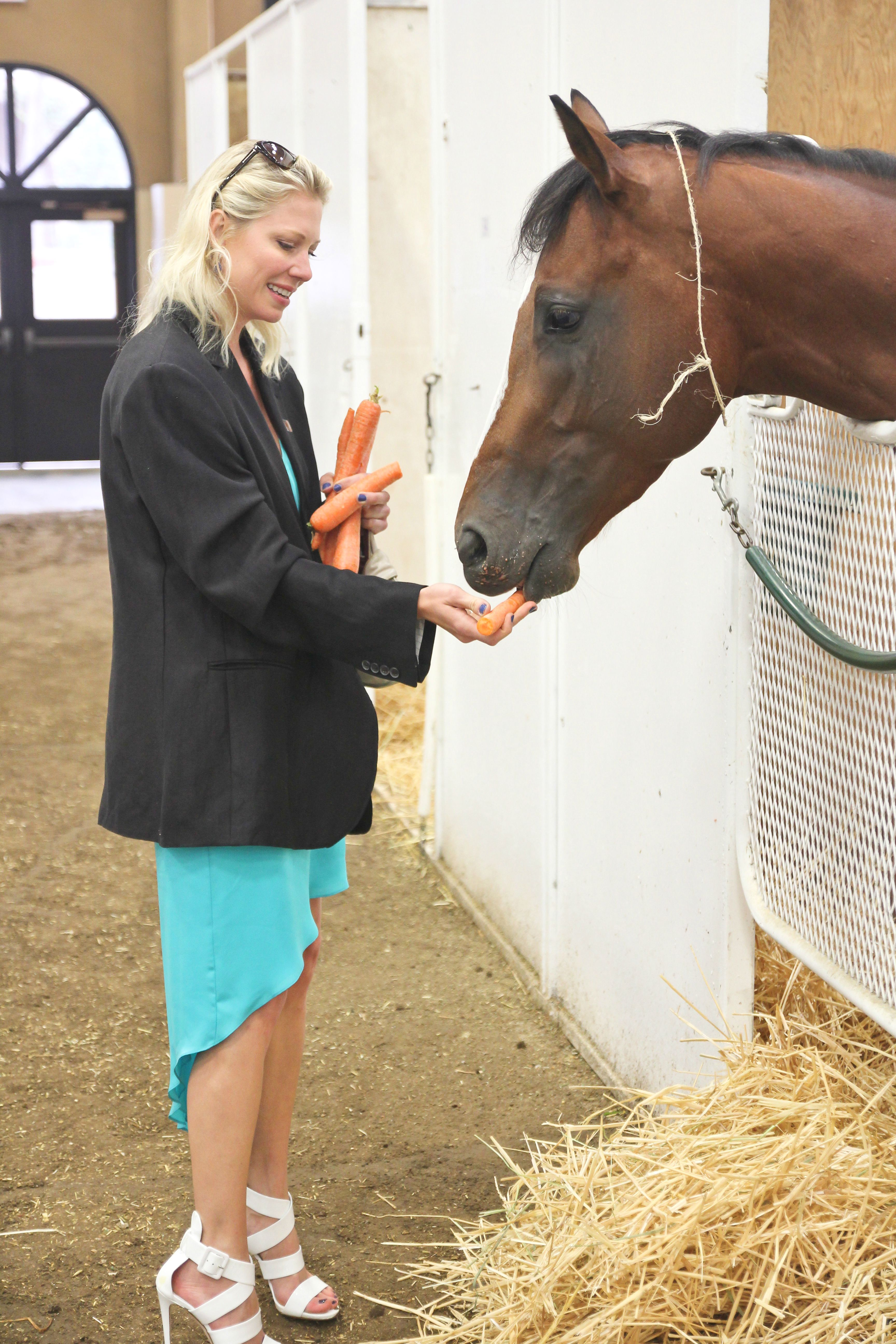 Mary feeding horse carrots 2013